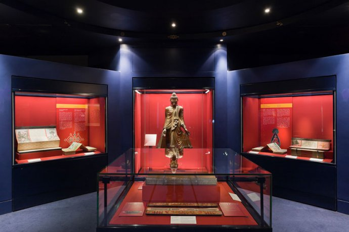 Statue, books and parchments on display