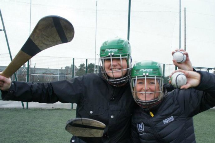 Group With Hurling Sticks Experiencing Gaelic Games in Dublin