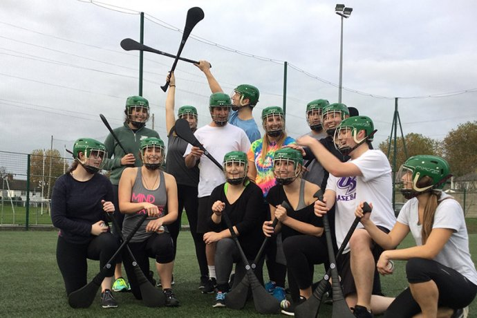 Group With Hurling Sticks Celebrating Gaelic Games Victory in Dublin