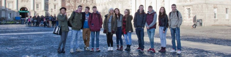 Group of students on a tour in Dublin - visiting Trinity College