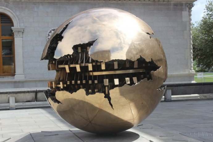The sphere within sphere sculpture is located in the courtyard