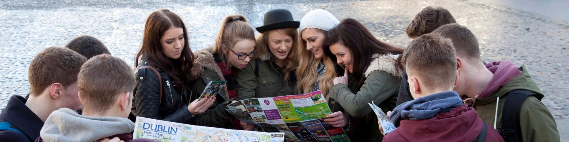 Group of students on a tour in Ireland with maps and brochures