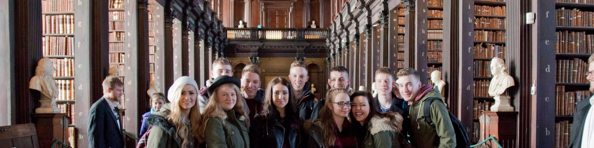 Group of students on a tour in Dublin at Trinity College Library