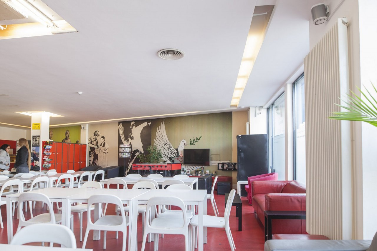 Tables in the Breakfast Area in Youth Hostel Lounge