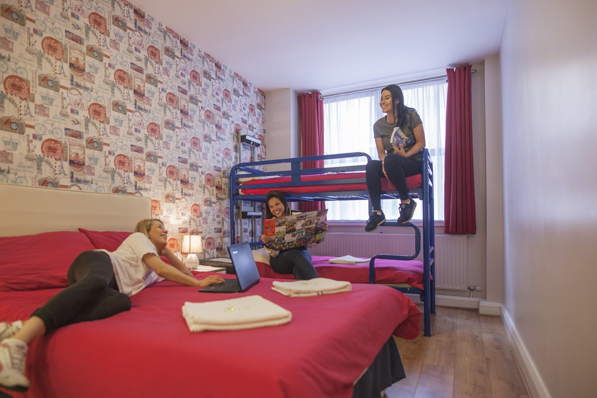 Three Guests in Triple Room in Youth Hostel
