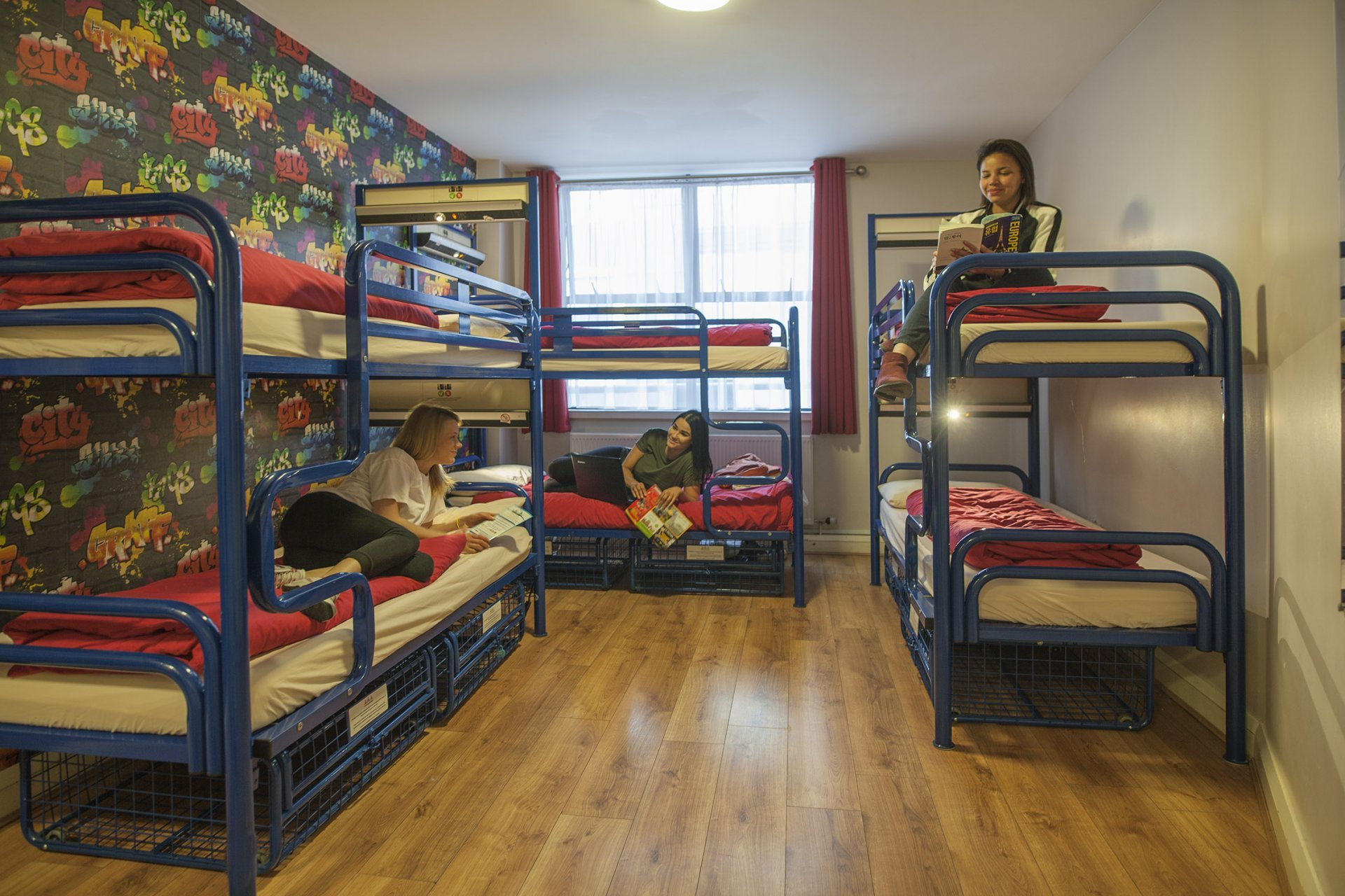 Guests From Group of Students on Bunk Beds in Youth Hostel 6 Bed Room