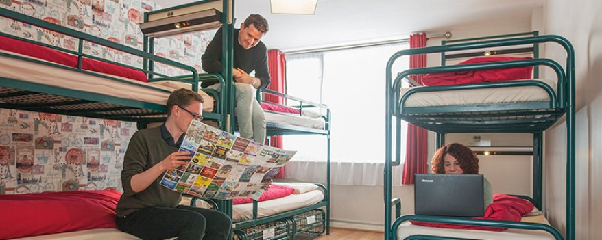 Tourists Chatting on Bunk Beds in Six Bed Room in Hostel