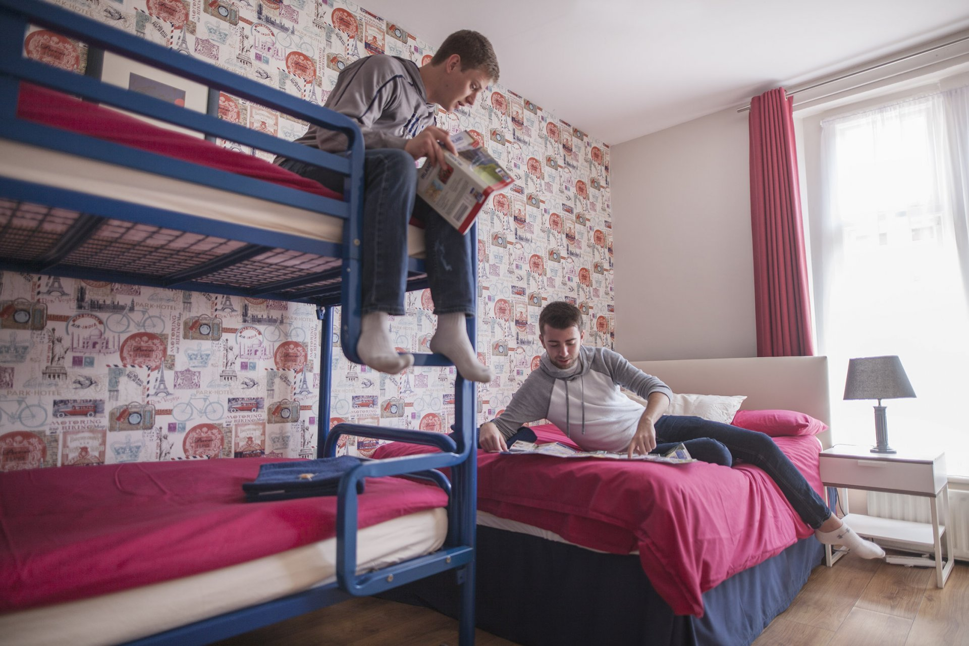 Tourist Students Chatting in Hostel Room