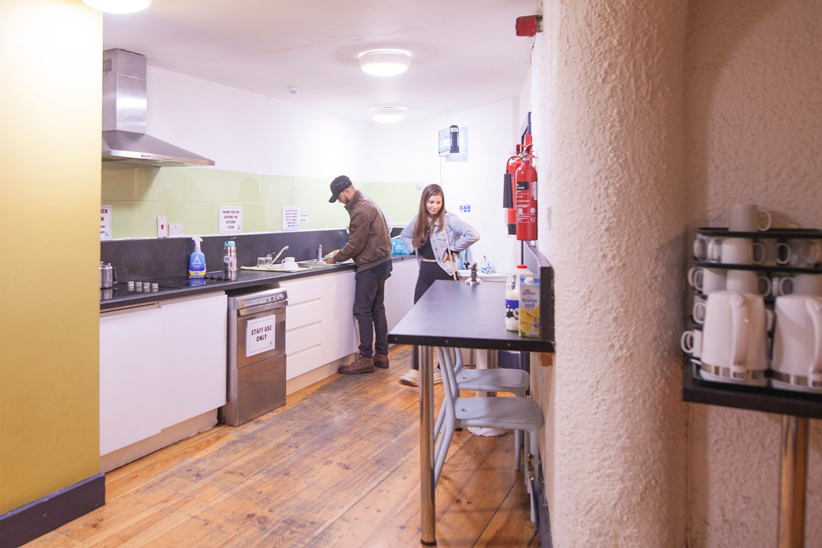 Tourists Preparing Food in the Self-Catering Kitchen in Hostel