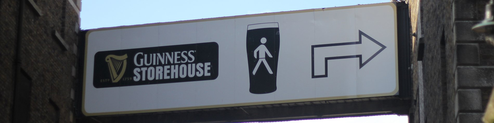 Sign of Guinness Storehouse in Ireland with an arrow towards the entrance