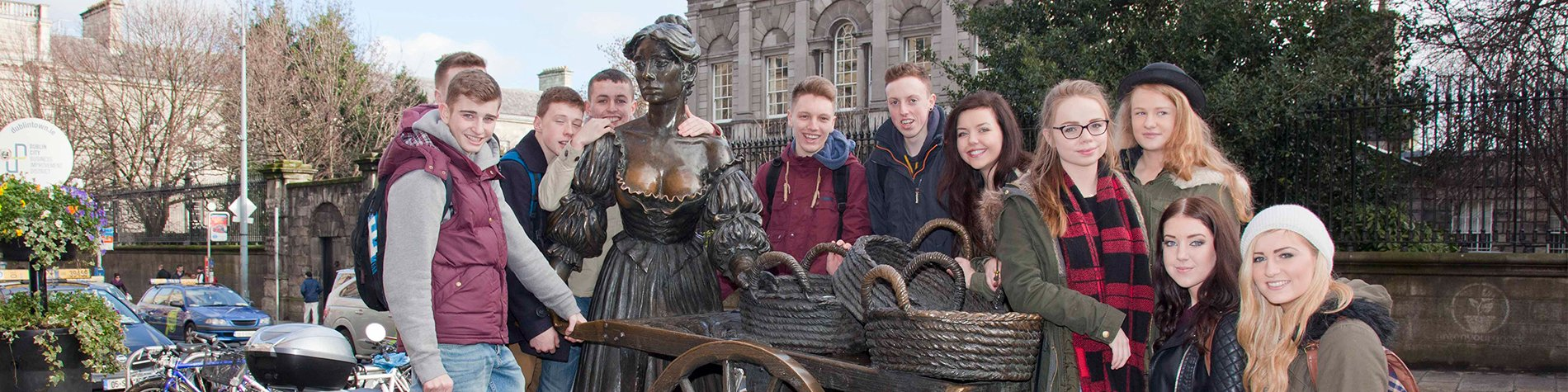 Group with Molly Malone Statue in Ireland