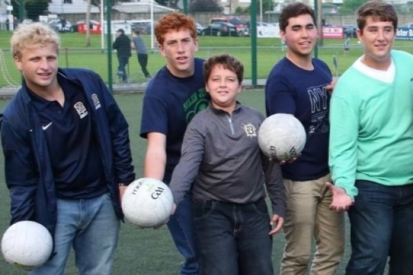 Group of students holding their GAA ball in their hands