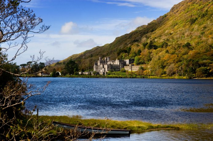 View over Kylemore Abbey from the opposite side of the lake on a sunny day