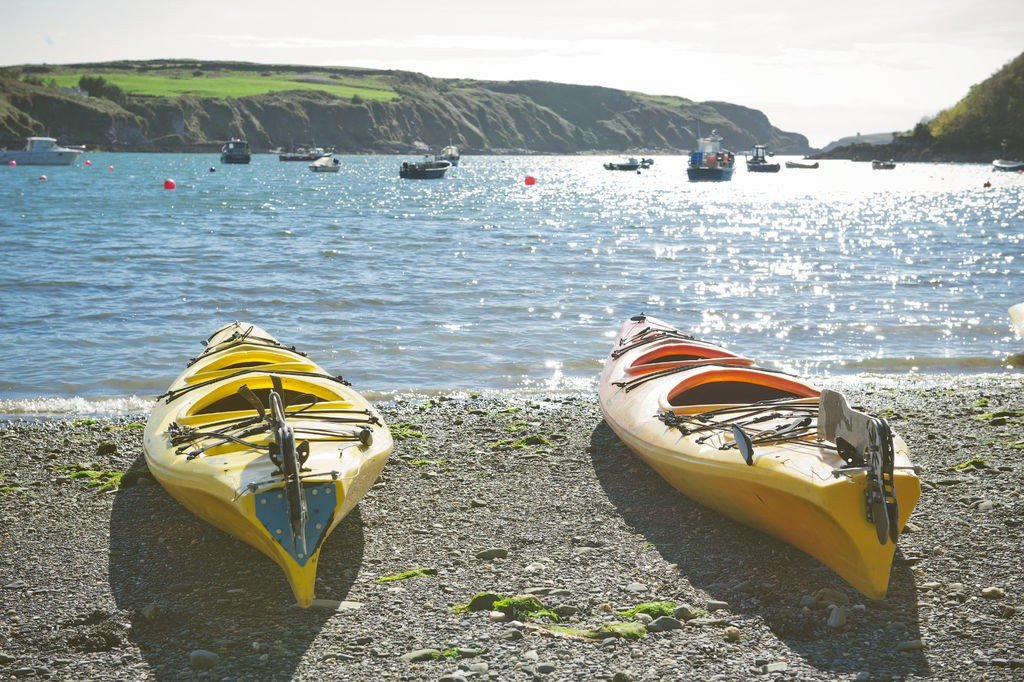 Sea Kayaks on the Beach Waiting For Exploring Coastal Trip of the South Western Ireland